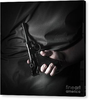 Male Hand Hiding Vintage Luger Pistol Behind Back Canvas Print by Jorgo Photography - Wall Art Gallery