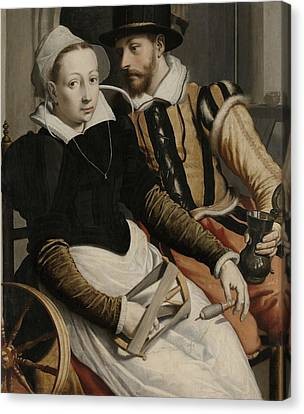 Man And Woman At A Spinning Wheel Canvas Print