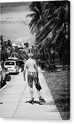 Man Rollerblading Along Ocean Drive Early Morning Art Deco District Miami South Beach Florida Usa Canvas Print by Joe Fox