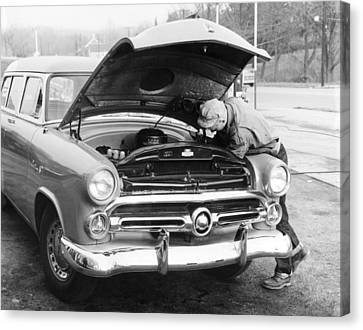 Man Working On His Car Canvas Print by Underwood Archives