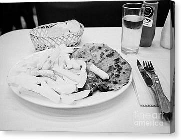 milanesa steak with french fries in a cafe Santiago Chile Canvas Print