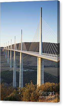 Millau Viaduct At Sunrise Midi-pyrenees France Canvas Print by Colin and Linda McKie