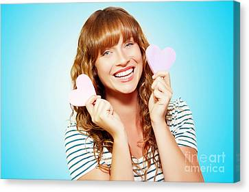 Mischievous Valentine Girl Holding Two Love Hearts Canvas Print by Jorgo Photography - Wall Art Gallery