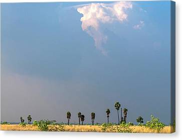 Monsoon Clouds Over Landscape Canvas Print by K Jayaram