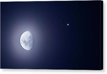 Moon And Jupiter Canvas Print by Luis Argerich