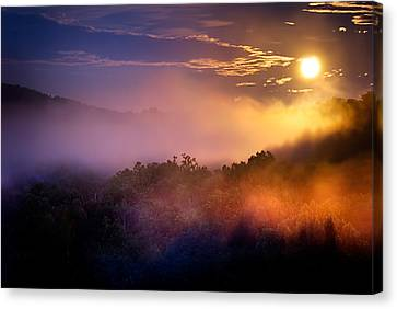 Moon Setting In Mist Canvas Print by Robert Charity