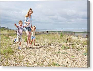 Mother And Children On Beach Canvas Print by Ian Hooton