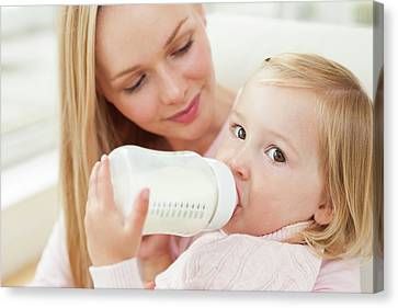 Mother And Daughter With A Bottle Canvas Print