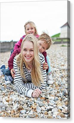 Mother With Children On Beach Canvas Print by Ian Hooton