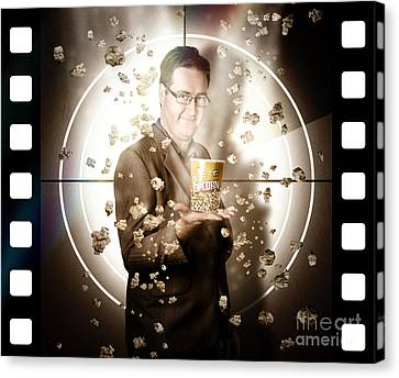 Movie Man Holding Cinema Popcorn Bucket At Film Canvas Print by Jorgo Photography - Wall Art Gallery