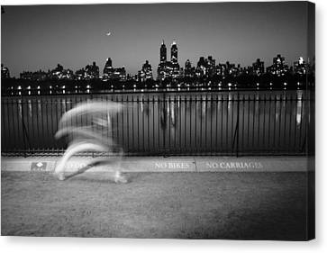 Night Jogger Central Park Canvas Print by Dave Beckerman