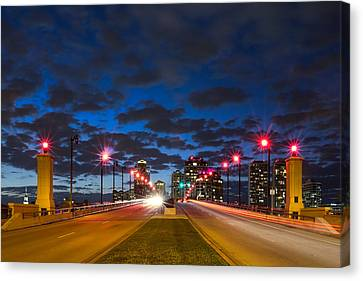 Night Lights Canvas Print by Debra and Dave Vanderlaan