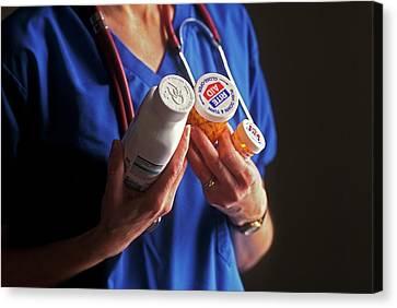 Nurse With Anti-hiv Medications Canvas Print