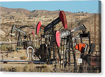 Oil Production Canvas Print by Jim West