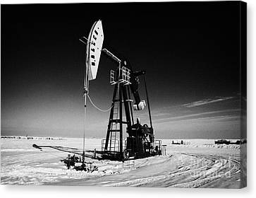 oil pumpjack in winter snow Forget Saskatchewan Canada Canvas Print