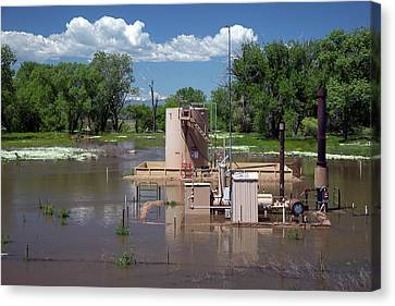 Flooding Canvas Print - Oil Well Flooded By River by Jim West