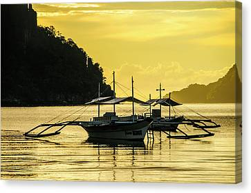 Outrigger At Sunset In The Bay Of El Canvas Print by Michael Runkel