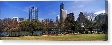 Park With Skyscrapers Canvas Print by Panoramic Images