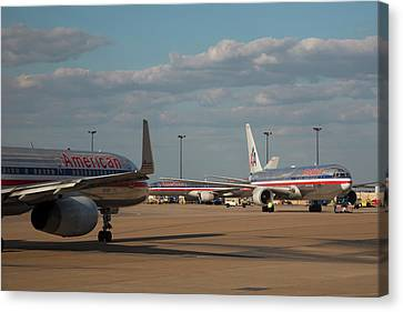 Passenger Airliners At An Airport Canvas Print by Jim West
