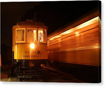 Passing In The Night Canvas Print by Jim Poulos
