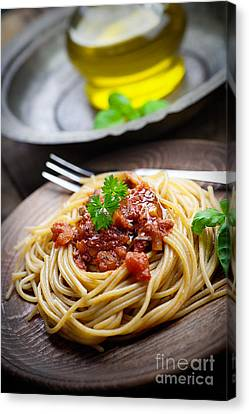 Pasta With Tomato Sauce Canvas Print by Mythja  Photography