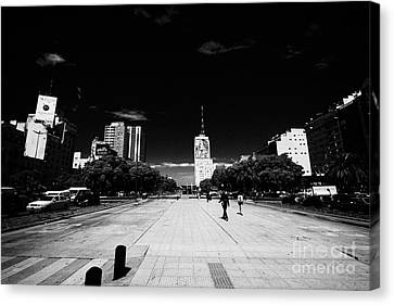 pedestrian area and bus lanes in the middle of avenida 9 de julio Buenos Aires Argentina Canvas Print by Joe Fox