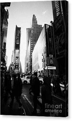 Pedestrians Walking Across Crosswalk Times Square In Daytime New York City Canvas Print by Joe Fox