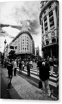 Crosswalk Canvas Print - people crossing calle florida Edificio Bencich and south end of florida street downtown Buenos Aires by Joe Fox