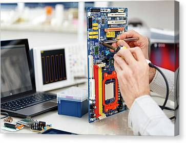 Person Repairing Electronic Circuit Board Canvas Print