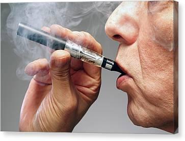 Person Smoking E Cigarette Canvas Print by Victor De Schwanberg