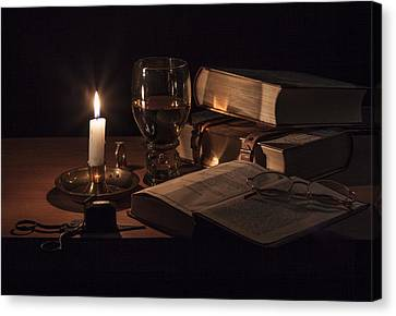 Canvas Print featuring the photograph Vanitas With Lit Candle-roemer And Books by Levin Rodriguez
