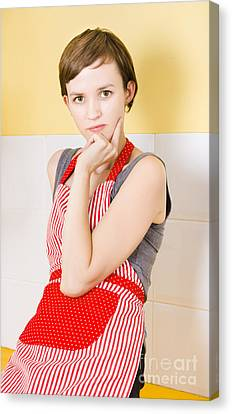 Portrait Of A Thinking Cook On Kitchen Background Canvas Print by Jorgo Photography - Wall Art Gallery