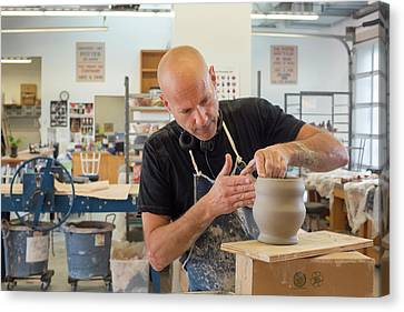 Potter At Work Canvas Print by Jim West