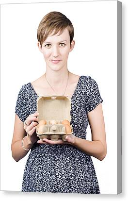 Youthful Canvas Print - Pregnant Young Woman Displaying A Box Of Eggs by Jorgo Photography - Wall Art Gallery