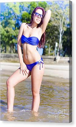 Pretty Woman Wearing Bikini Sunbathing At The Beach Canvas Print