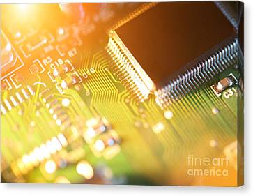 Processor Chip On Circuit Board Canvas Print by Konstantin Sutyagin