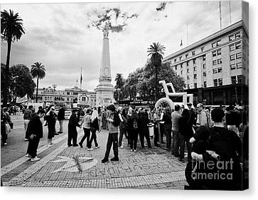 public protest and demonstration plaza de mayo main square downtown Buenos Aires Argentina Canvas Print by Joe Fox