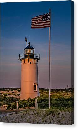 Race Point Lighthouse And Old Glory Canvas Print by Susan Candelario