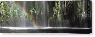 Rainbow Formed In Front Of Waterfall Canvas Print by Panoramic Images
