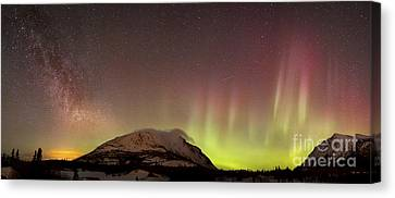 Red Aurora Borealis And Milky Way Canvas Print by Joseph Bradley