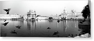 Golden Temple Canvas Print - Reflection Of A Temple In A Lake by Panoramic Images
