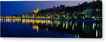 Reflection Of Buildings In Water Canvas Print by Panoramic Images