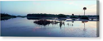 Reflection Of Clouds In Water Canvas Print