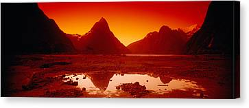 Reflection Of Mountains In A Lake Canvas Print by Panoramic Images