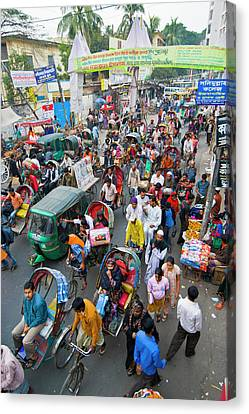 Rickshaws In Traffic On A Street Canvas Print by Michael Runkel