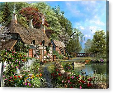 Riverside Home In Bloom Canvas Print by Dominic Davison