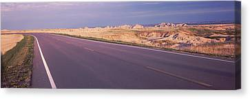 Road Passing Through The Badlands Canvas Print
