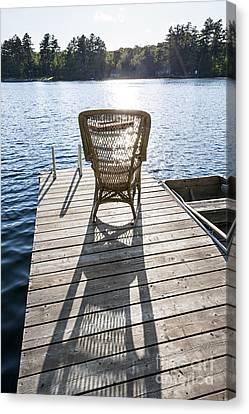 Rocking Chair On Dock Canvas Print by Elena Elisseeva