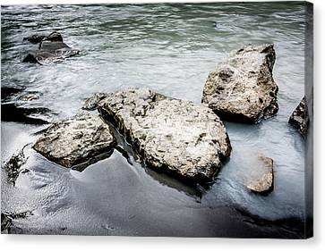 Rocks In The River Canvas Print by Andrew Matwijec