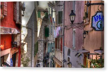 Street Lamps Canvas Print by Uri Baruch